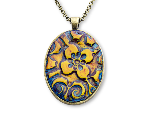 An interesting oval pendant, on silver backing and chain, with a cloissonne flower design of amber color on Prussian blue background.