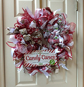 A wonderful candy cane wreath, with Christmas colors of red and white.