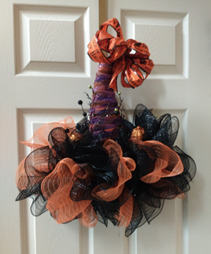A truly wonderful wreath in the shape of a witch's hat. Great colors though mostly black.