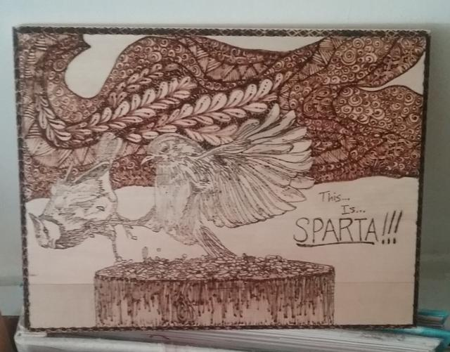 intricate woodburning with birds