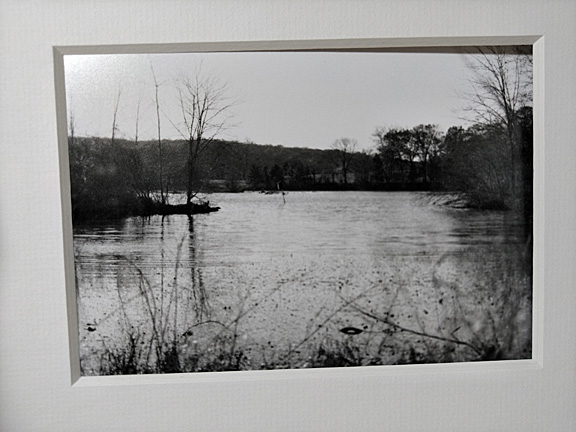 framed black & white photograph of a wintery river