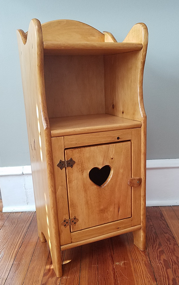 Small wooden side cabinet in the American Colonial style.