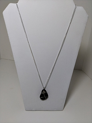 pendant of black teardrop flat stone on silvery chain