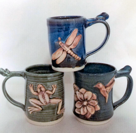 ceramic mugs with raised anmal shapes