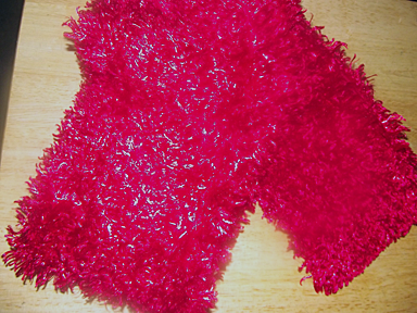 Pink furry scarf.