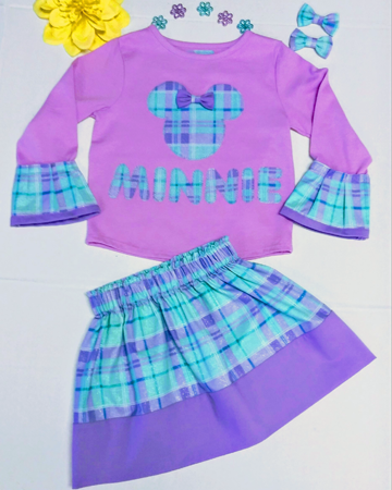 "A cute coordinated little girl's outfit using blue and purple plaids along with solids with the same print in the top saying ""Minnie"".."