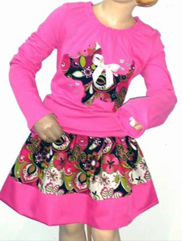 A pink coordinated top and skirt.The top has a cloth animal using the same print as is also on the skirt.  The animal sports a white bow.