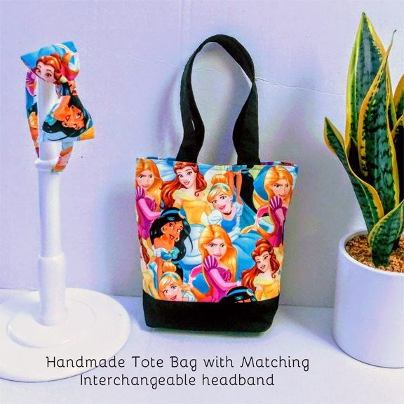 Fabric bag with a matching headband bow, using a print of various Disney princesses.