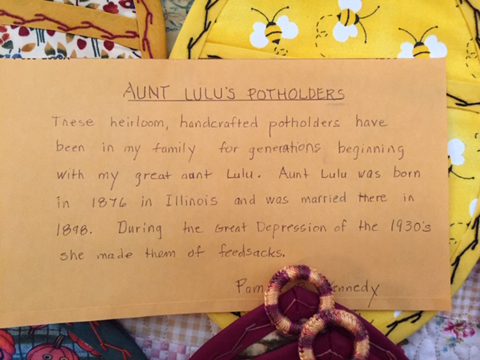 An index card tells the story of the crafter's great aunt Lulu who was married in 1998 and made pot-holders like these. In the depression, the 1930s, she made them out of feed-sack-cloth.