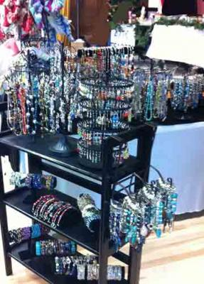 display of jewelry on a bookshelf