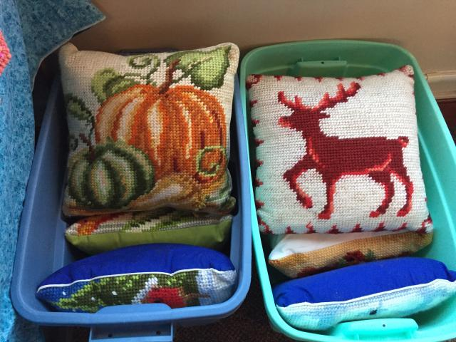 throw pillows with needlework drawings