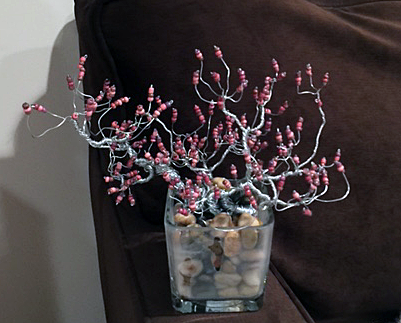 redbud in glass with rocks