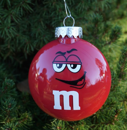 Round red ornament as a red M&M with snarky expression