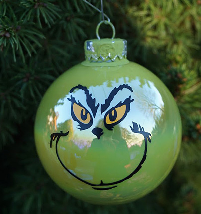 round green ornament with Grinch face