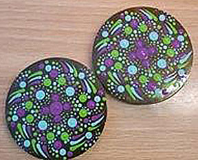 Two identical round button-pins. They appear to be three inches diameter each.