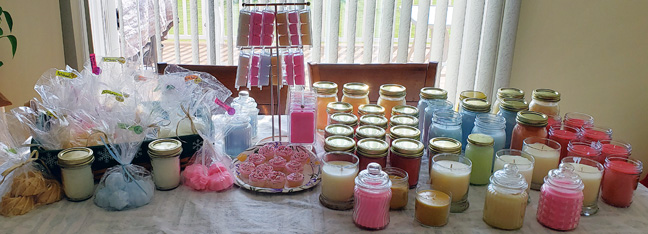 Various pretty candles, some in jars and some in bags, some on a platter looking rather edible.
