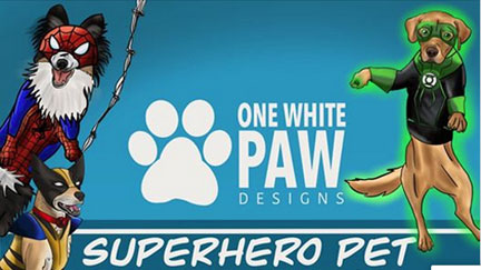 Cartoon dogs dressed in super-hero costumes flank the name One Paw Designs.
