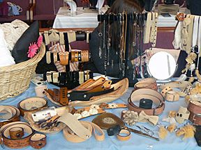 Various leather goods as guitar straps, belts, purses, leather strap bracelets, bow ties, etc.