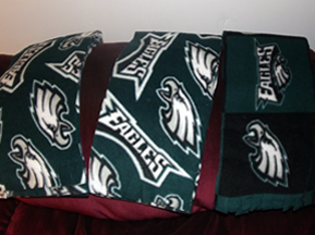 "White Eagles symbol on a dark Eagles' green. Two scarves same colors, but one has smaller ""Eagles"" word and eagles head, so more green shows."