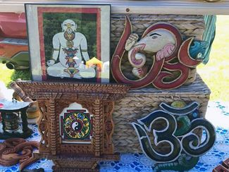 This picture is of several items that Duchovnay and Urbas create.  There is a painting/colored drawing of an Eastern religion god, and elephant head with designs, a 35 and a clock or plack.