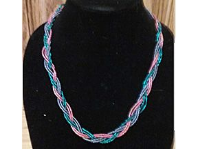 beaded necklace in pink, blue and teal braided together-about 22 inches