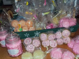 Jars of candles, bags of colored tea-lights, candles looking like frosted cupcakes.